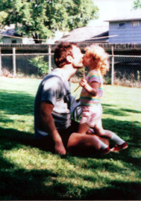 My father and I in our backyard.