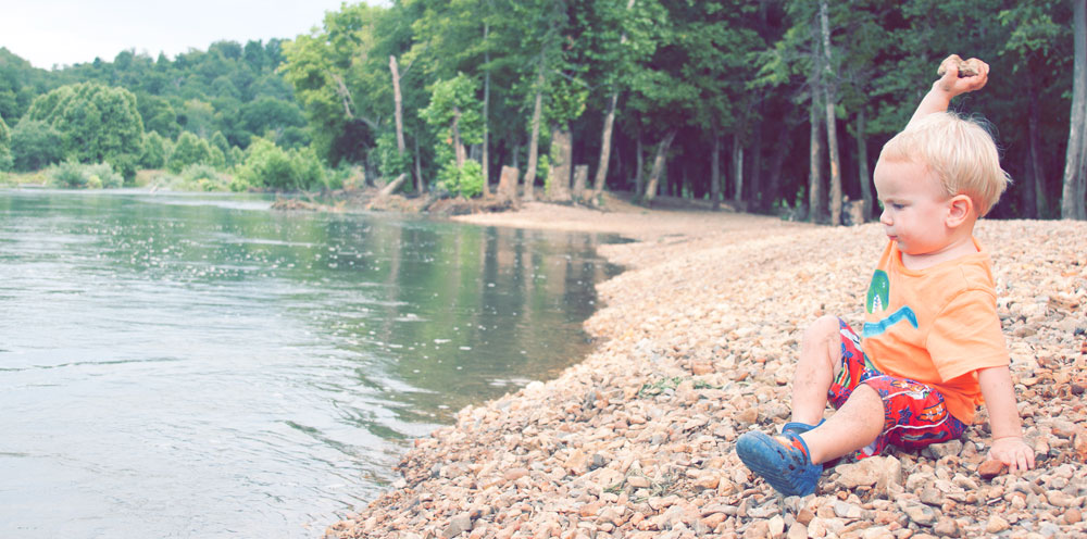 Alden Throwing Rocks on family vacation in Missouri