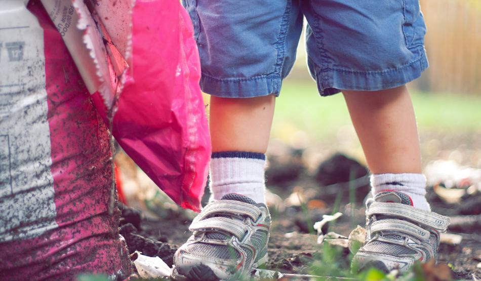 child's feet in dirt