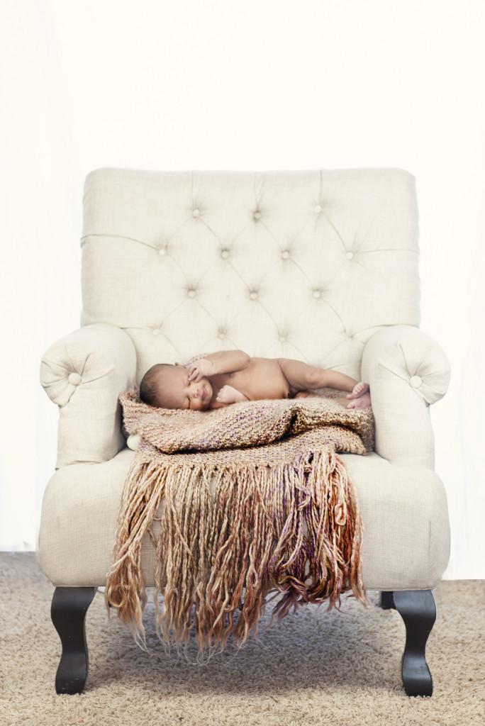 Newborn Photography by Liz Davenport Creative of baby sleeping on cream chair